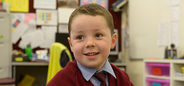 A picture of a reception student discussing his enjoyment in learning